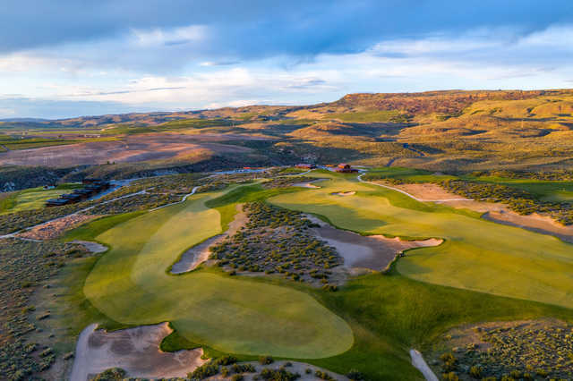 View of the 1st tee on the left and the 18th green and clubhouse on the right side at Gamble Sands Golf Club.
