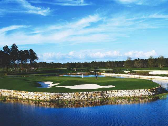 A view of the 8th hole surrounded by water and bunkers at The Conservatory Course from Hammock Beach Resort.