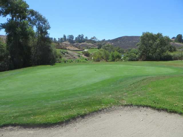 A sunny dya view of a green at Strawberry Farms Golf Club.