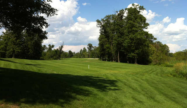 A sunny day view of a fairway at Refuge Golf Club.