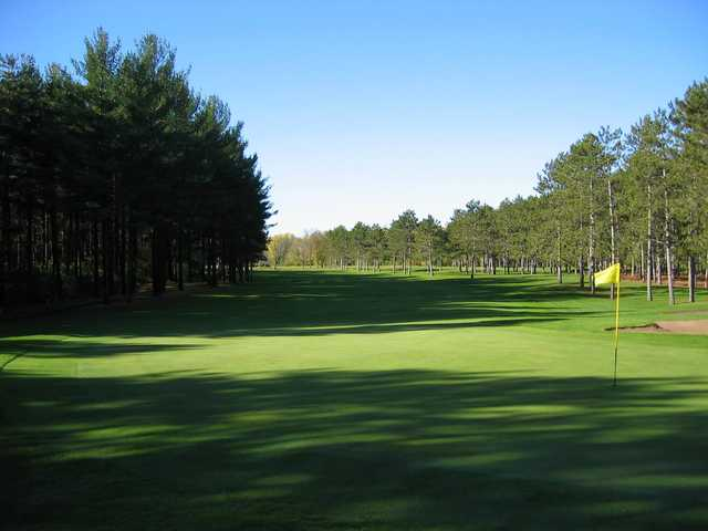 A sunny day view of a green at New Richmond Golf Club.