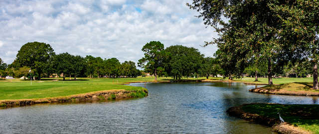 A view of a green with water coming into play at Belle Terre Country Club.