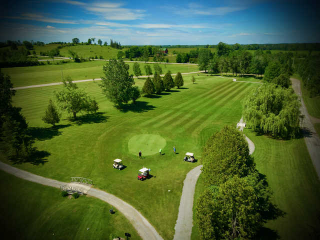 Aerial view of a green from Deer Run Golf Course.