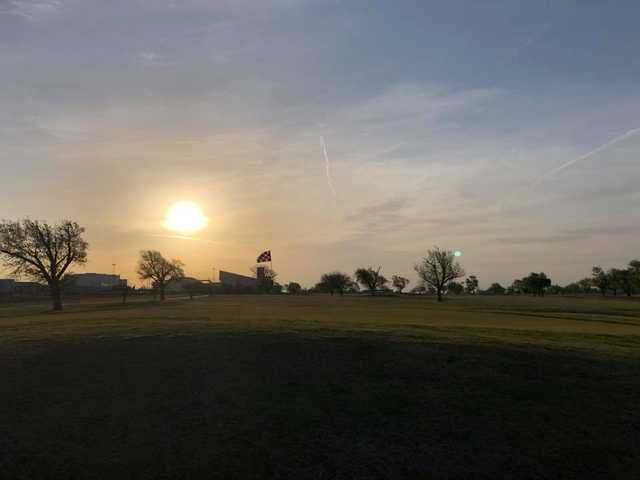 A sunset view of hole #4 from The Greens of Altus Golf Course.