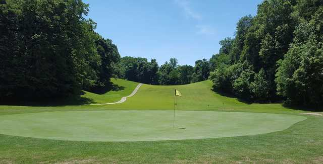 A sunny day view of a hole at John James Audubon Golf Course.
