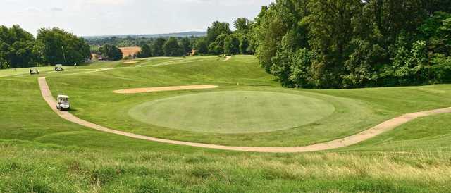 A view of a manicured green at John James Audubon Golf Course.