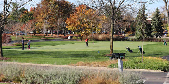 A fall day view of the practice putting green at Deerfield Golf Club.