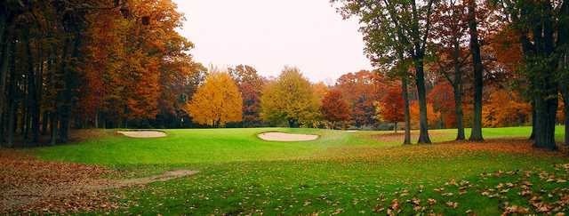 A fall day view of a hole at River Island Golf Course.