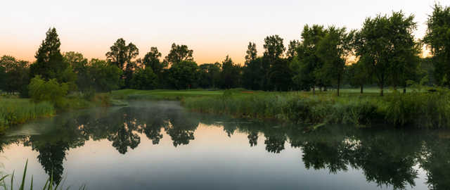 A view over the water of a hole at Deerpath Golf Course.