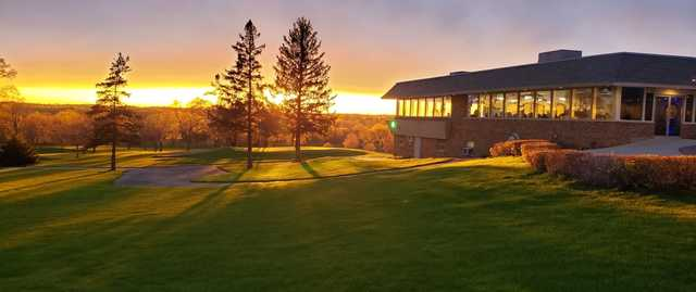 A sunset view of the clubhouse at Bristol Oaks Golf Club and Banquet Center.
