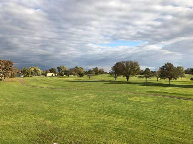 A sunny day view of a hole at Burning Tree Golf Course.
