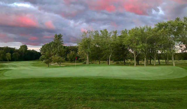 A sunrise view of a green at Muskego Lakes Country Club.