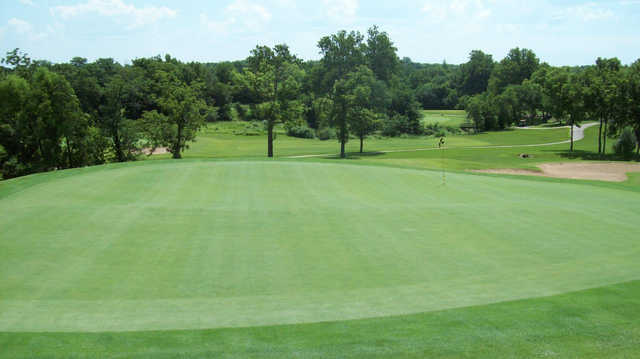 A sunny day view of a green at Grand Summit Golf & Country Club.