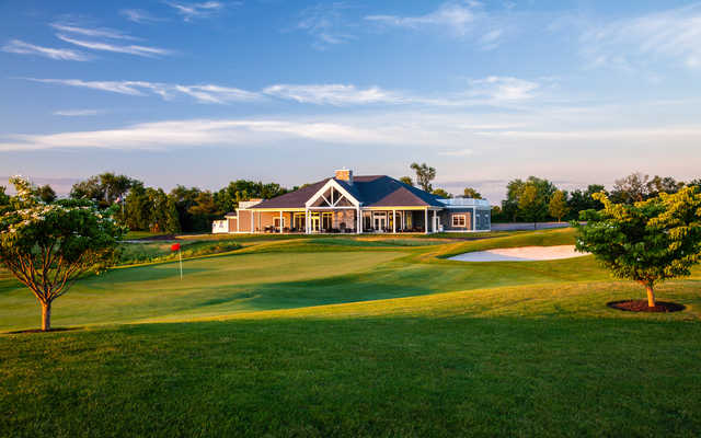 View of the 18th hole and clubhouse at Heron Glen Golf Course.
