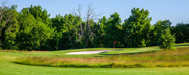 View of a green at Heron Glen Golf Course.