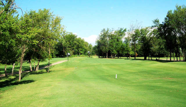 A sunny day view of a green at The Links from Stillwater Golf & Country Club.