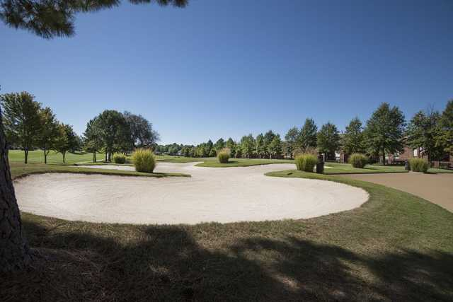 A view over a huge bunker from The Links at Springdale Golf & Country Club.