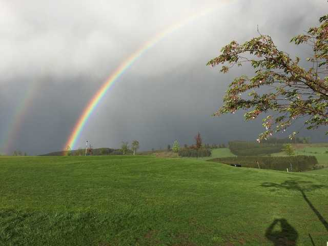 A view of a rainbow over Crooked Oak Golf Club.