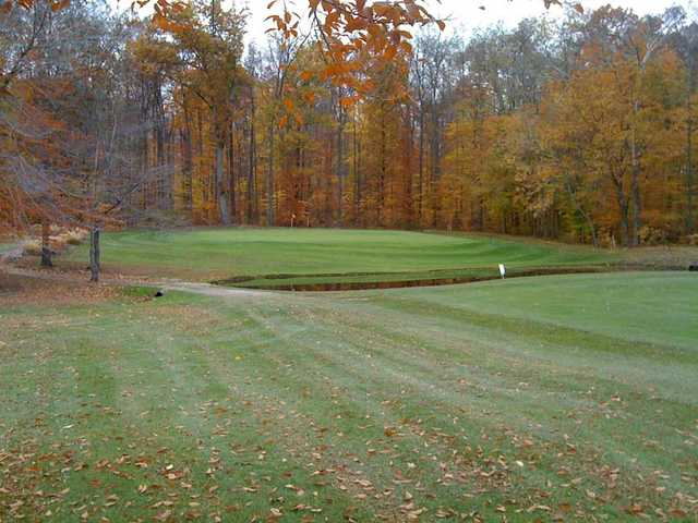 Fall view of a green at Rolling Green Golf Club.
