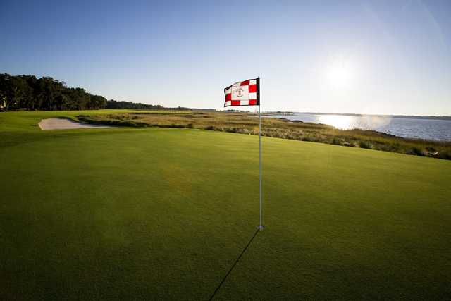 A sunny day view of a hole from Harbour Town Golf Links at Sea Pines Resort.