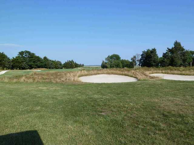 Lateral bunkers provide a risk-and-reward challenge on the Bay Course at Seaview resort.