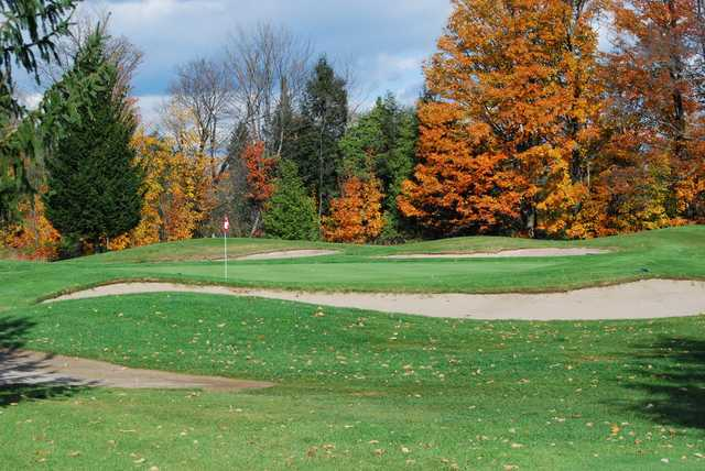 A fall day view of a hole at Mill Run Golf Club.