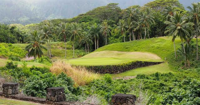 A sunny day view of a green at Royal Hawaiian Golf Club.