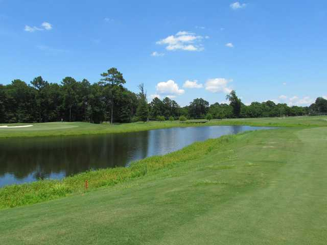 A view over the water of a green at Gateway Park Golf Course.