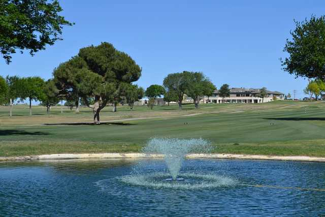 A view of a fairway and the clubhouse in the distance at Artesia Country Club.