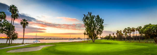 A sunset view of a green at Coronado Golf Course.
