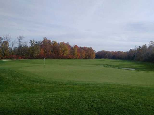 A fall day view of a green at Batteaux Creek Golf Club.