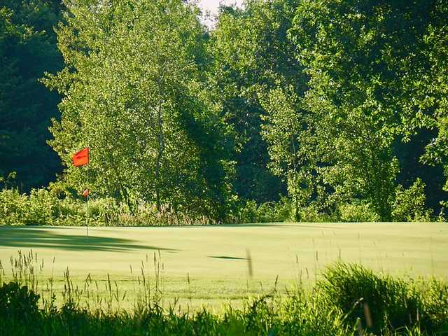A sunny day view of a hole at Ponemah Green Family Golf Center.
