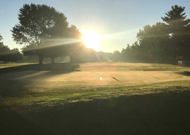A sunny day view of a green at Maxwelton Golf Club.