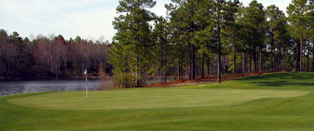 A view of a green with water in background at Legacy Golf Links.