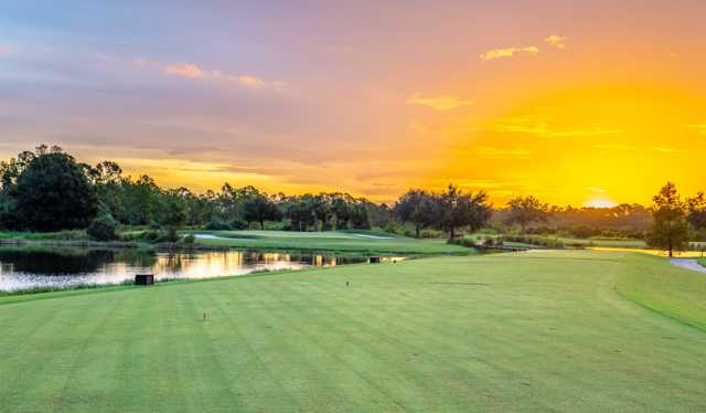 A sunset view of a well protected hole at River Hall Country Club.