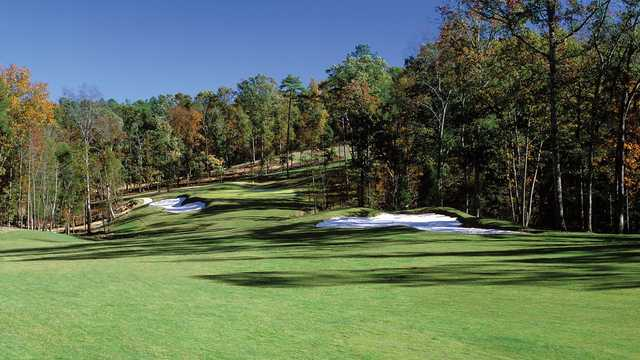 An early fall day view of a green from The Preserve at Jordan Lake Golf Club.