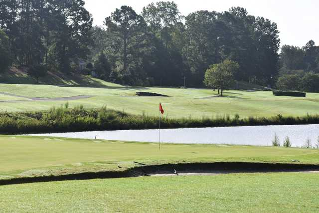 A view of a green protected by a pond at Ford's Colony Country Club.