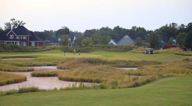 A view of a green with water coming into play at TimberLake Golf Club.