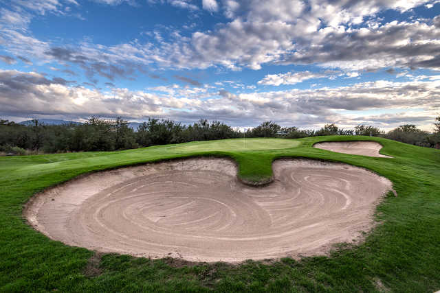 View of the 12th green and bunkers at Arizona National Golf Club.