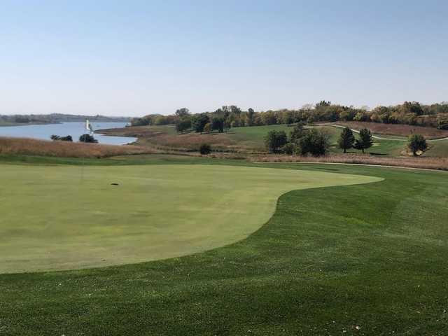 A fall day view of a green at Mozingo Lake Recreation Park Golf Course.