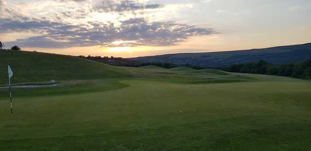 A sunset view of a hole at Garnant Park Golf Club.