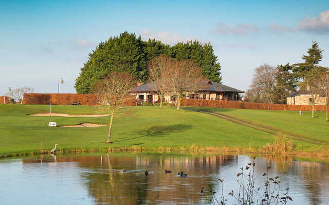 A view of the clubhouse and a green at Craddockstown Golf Club.