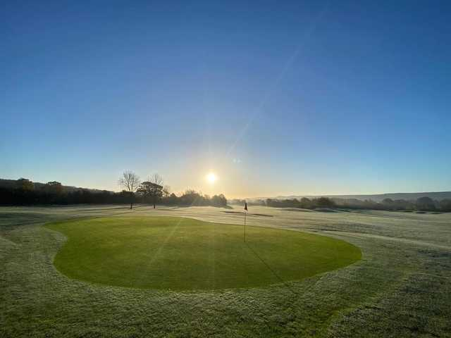 A sunny morning view of a hole at Mid Sussex Golf Club.