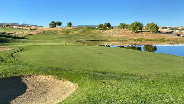 A sunny day view of a hole at Poppy Ridge Golf Course.