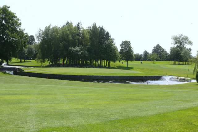 A view of the 9th hole at Meadow Course from Corrstown Golf Club.