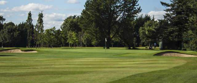 A view of a green flanked by bunkers at Foxrock Golf Club.