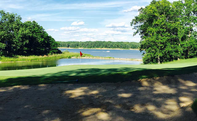 A sunny day view of a hole at Eagle Creek Golf Course.
