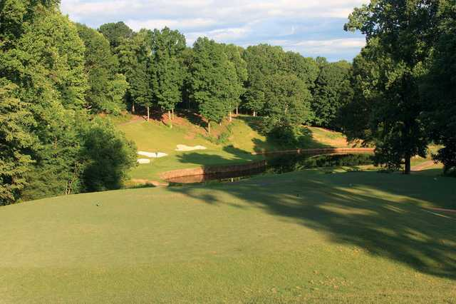 A sunny day view of the 6th green at Jackson Course from Rock Barn Golf and Spa.