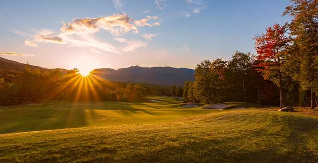 A sunny day view of fairway #18 at Sunday River Golf Club.