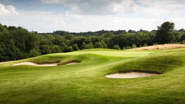 A view of a green surrounded by bunkers at Dale Hill Course from Dale Hill Hotel & Golf Club.